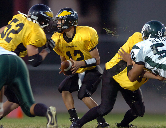 Thompson Valley quarterback #12 looks to hand off the ball Friday during their game against Niwot High School.