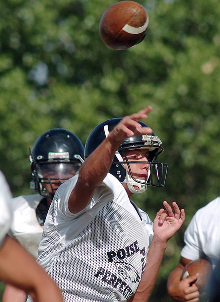 Thompson Valley High School quarterback Spencer Shook throws a pass during practice Wednesday.