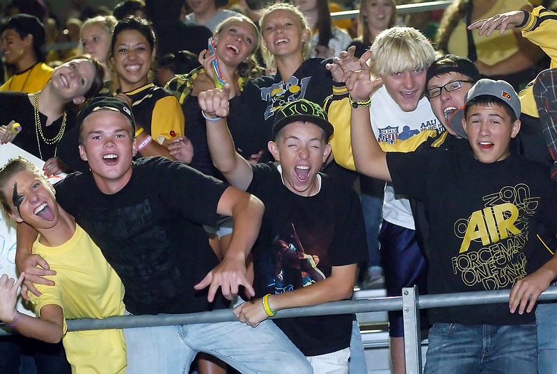Thompson Valley High School football fans cheer on the team during a game against Green Mountain on Thursday night at Patterson Stadium. The Eagles lost, 26-6.