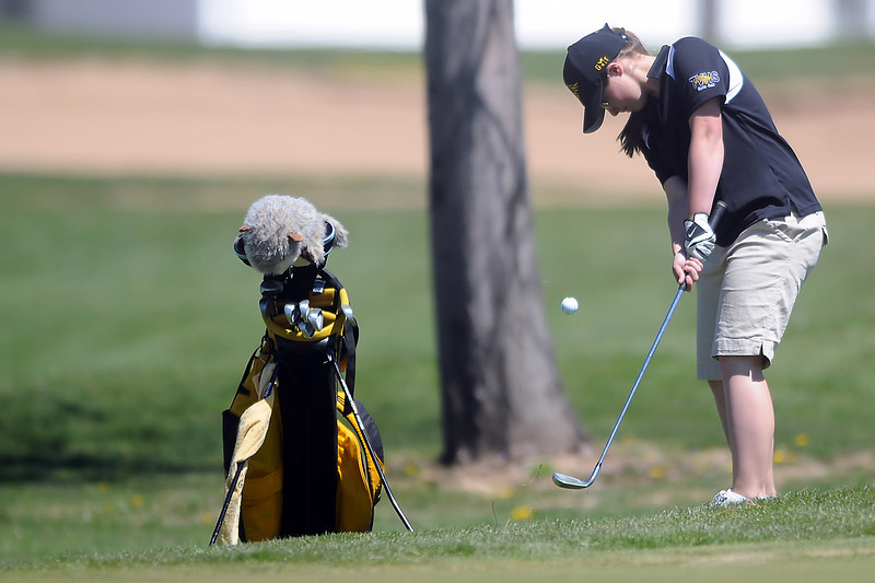 Thompson Valley High School's Regan Musilek chips onto the No. 1 green during the R2-J Invitational on Thursday, April 28, 2011 at Mariana Butte Golf Course.