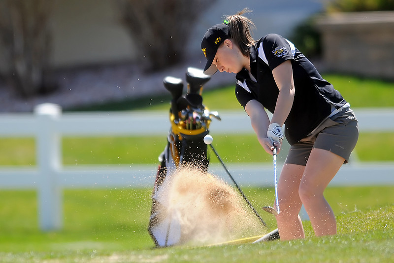 Thompson Valley High School senior Lauren Mickelson hits out of the sand during the R2-J Invitational on Thursday, April 28, 2011 at Mariana Butte Golf Course.