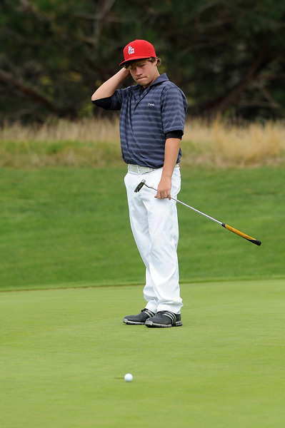 Thompson Valley High School freshman Josh McLaughlin reacts after missing a putt on the 10th hole Tuesday at Mariana Butte Golf Course.
