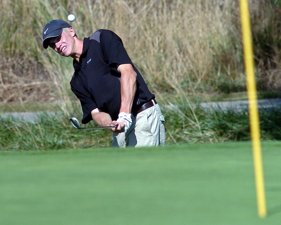 Thompson Valley High School's Jay Cooper chips onto the No. 7 green at Mariana Butte Golf Course on Sept. 15, 2010 during a Northern Conference meet.