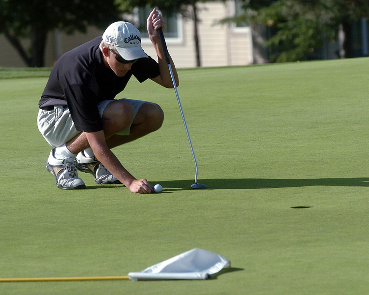 Thompson Valley High School's Zack Dwyer lines up his putt on No. 9 at Mariana Butte Golf Course on Sept. 15, 2010 during a Northern Conference meet.