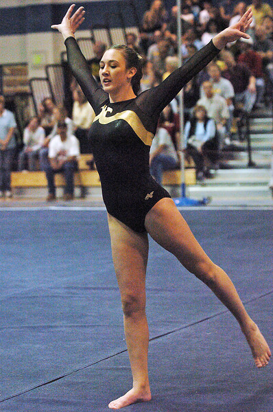 Thompson Valley High School's Naomi Winick performs her floor routine during the preliminary session of the State Gymnastics Championships on Friday, Nov. 6, 2009 at Thornton High School.