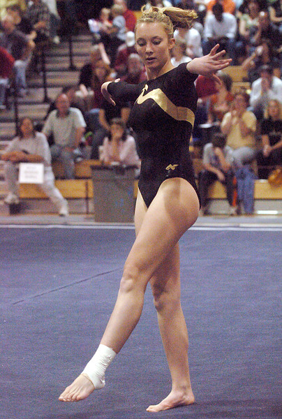 Thompson Valley High School's Ashleigh Waterland competes in the floor exercise during the preliminary session of the Class 5A State Gymnastics Championships on Friday, Nov. 6, 2009 at Thornton High School.