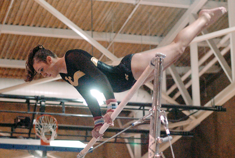 Thompson Valley High School's Naomi Winick competes on the uneven bars during the preliminary session of the State Gymnastics Championships on Friday, Nov. 6, 2009 at Thornton High School.
