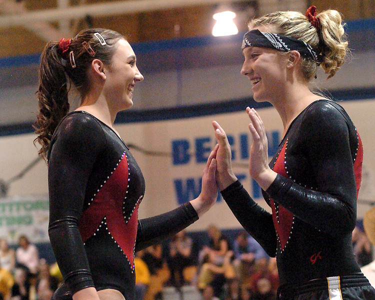 Thompson Valley High School gymnasts Naomi Winick, left, and Ashleigh Waterland share a laugh after Winick completed her routine on the balance beam during the individual finals of the Class 5A State Gymnastics Championships on Saturday, Nov. 7, 2009 at Thornton High School.