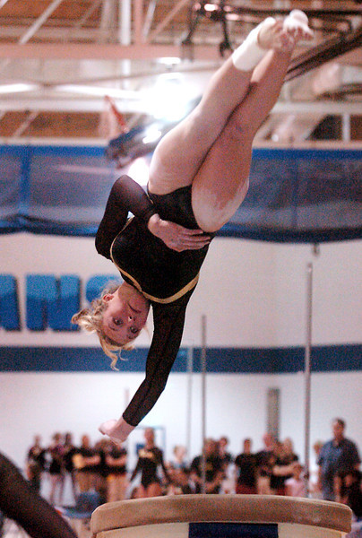 Thompson Valley High School's Ashleigh Waterland launches off the vault during the preliminary session of the Class 5A State Gymnastics Championships on Friday, Nov. 6, 2009 at Thornton High School.