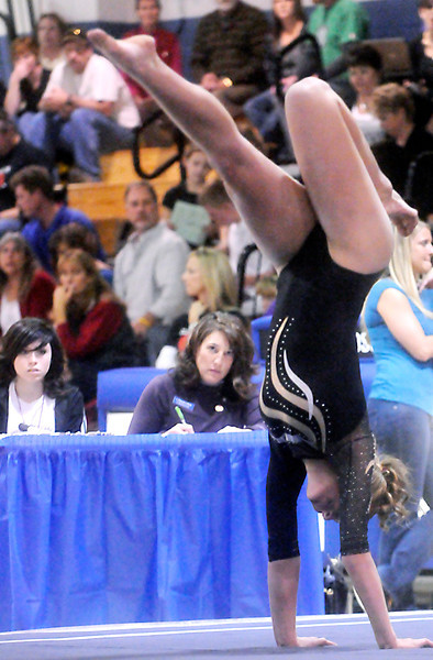 Thompson Valley High School's Ashleigh Waterland competes during the floor event at the gymnastics finals on Saturday afternoon. Waterland finished first overall to lead the Eagles team to a third place finish.