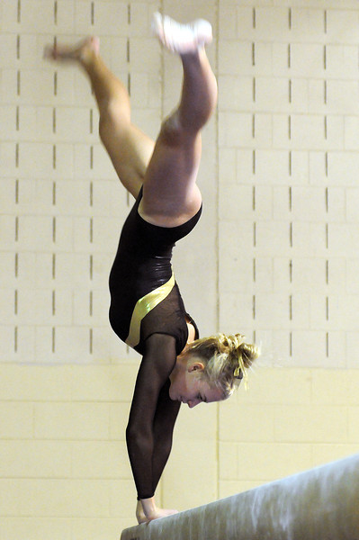 Thompson Valley High School junior Kelsey Hemberger performs a routine on the balance beam Tuesday night during a meet against Loveland High School at Thompson Valley.