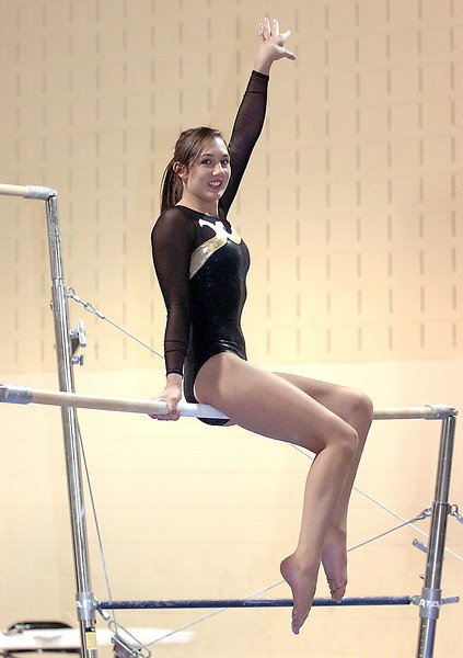 Thompson Valley High School gymnast Naomi Winick poses for a photo on the uneven bars Tuesday at the school in Loveland.