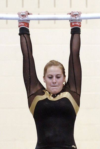 Thompson Valley High School's Nicole Thornton perfroms on the uneven bars during Tuesday's triangular meet at TVHS.