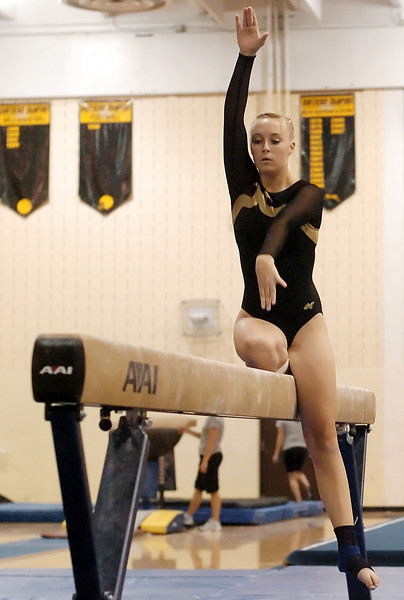 Thompson Valley High School's Brandi Peter performs her routine on the balance beam during Tuesday night's triangular meet at TVHS.