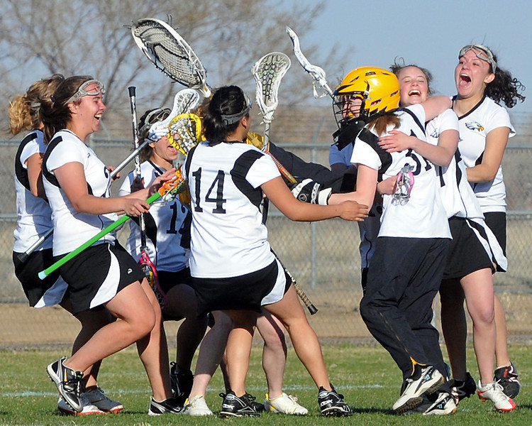 Thompson Valley High School lacrosse players celebrate their victory over Colorado Academy on Wednesday, April 7, 2010 at Patterson Stadium. The Eagles won, 9-8.