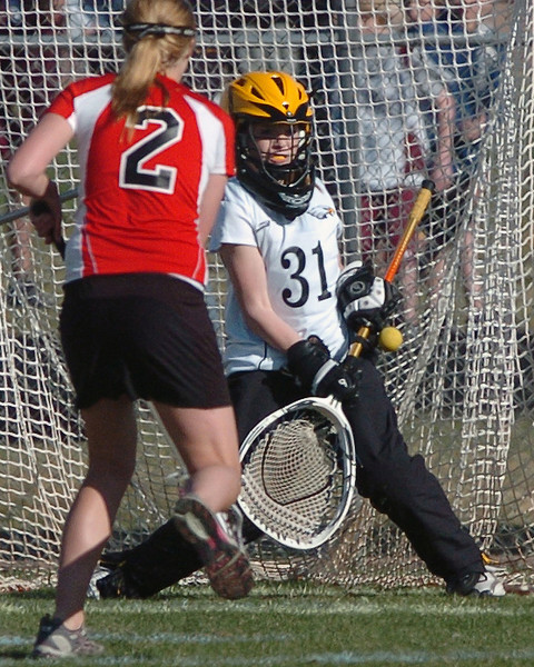 Thompson Valley High School goalie Molly Reger makes a stop in the second half of a game against Colorado Academy on Wednesday, April 7, 2010 at Patterson Stadium. The Eagles won, 9-8.
