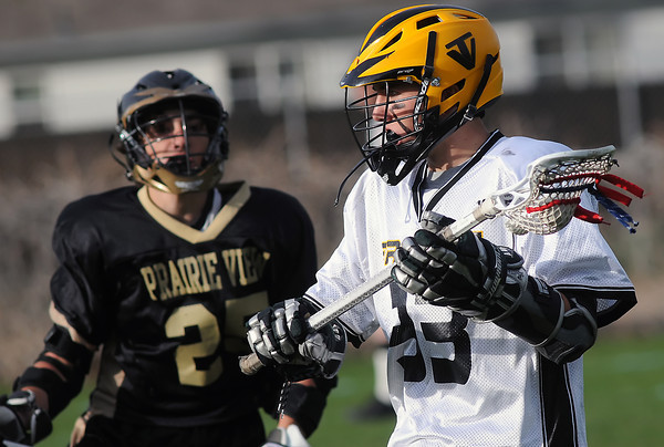 Thompson Valley High School's Ryan Windelhake looks for an open teammate in the fourth quarter of a game against Prairie View on Tuesday, April 27, 2010 at Patterson Stadium. The Eagles won, 17-9.