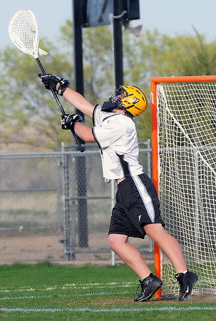 Thompson Valley High School goalie Steve Boggess makes a stop in the fourth quarter of a game against Prairie View on Tuesday, April 27, 2010 at Patterson Stadium. The Eagles won, 17-9.