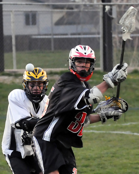 Thompson Valley High School attacker Ryan Spitz, left, and Fairview's Taylor Tuke eye the ball in the second quarter of their game on Tuesday, April 26, 2011 at Patterson Stadium. The Eagles lost, 15-2.