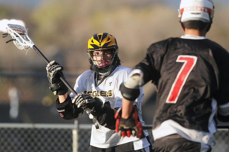 Thompson Valley High School midfielder Kris Garcia, left, works against Fairview defender Derek Rikke in the first quarter of their game on Tuesday, April 26, 2011 at Patterson Stadium. The Eagles lost, 15-2.