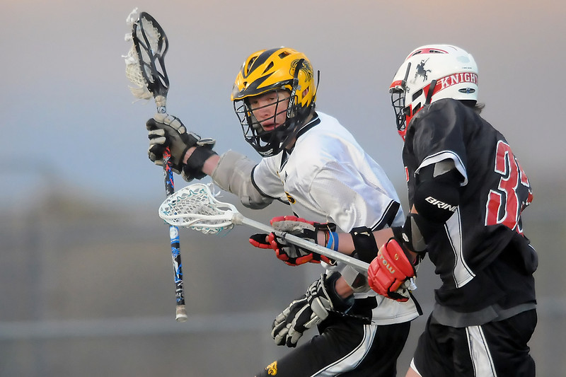 Thompson Valley High School midfielder Alex Fierstine, left, runs ahead of Fairview's Taylor Tuke in the second quarter of their game on Tuesday, April 26, 2011 at Patterson Stadium. The Eagles lost, 15-2.