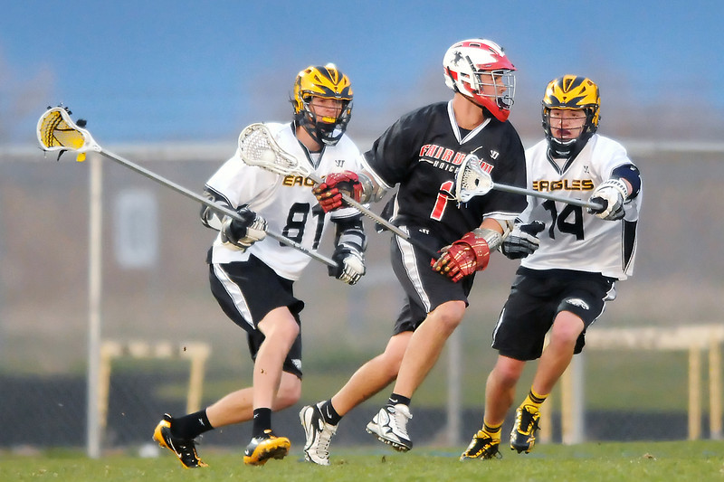 Thompson Valley High School defenders Conor Lang (81) and Kyle Harding (14) converge on Fairview attacker Logan Bonsignore in the second quarter of their game on Tuesday, April 26, 2011 at Patterson Stadium. The Eagles lost, 15-2.