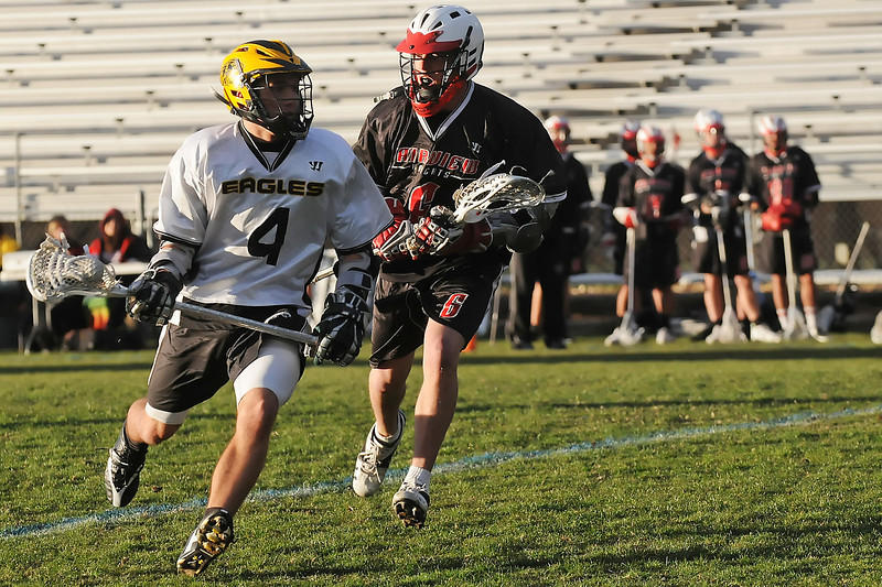 Thompson Valley High School midfielder Ryan Winkelhake, left, runs around Fairview defender Peter Ahlstrand in the first quarter of their game on Tuesday, April 26, 2011 at Patterson Stadium. The Eagles lost, 15-2.