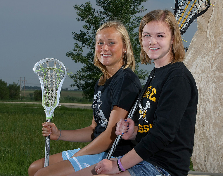 Maggie Mawhinney, left, and Megan Golliher who both play for the Thompson Valley High School lacrosse team, are Loveland's All Area Girls Lacrosse players.