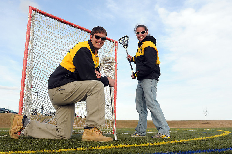 Posing together Saturday at the Loveland Sports Park are the new head coaches for the Thompson Valley High School boys and girls lacrosse teams, respectively, Rich Modesti, left, and Liz Melahn.