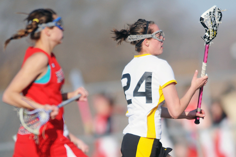 Thompson Valley High School's Rachel Washam, right, is pursued by Regis Jesuit's Kathryn Blumhardt in the second half of their match on Friday, March 18, 2011 at Patterson Stadium. The Eagles lost, 17-6.