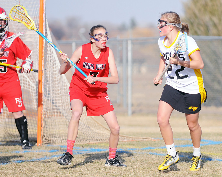 Thompson Valley High School's Maggie Mawhinney, right, during a match against Regis Jesuit on Friday, March 18, 2011 at Patterson Stadium. The Eagles lost, 17-6.
