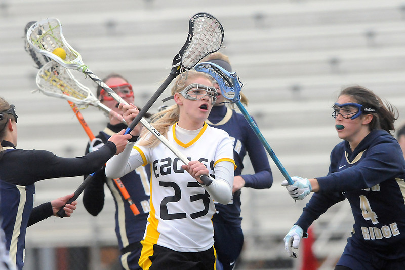 Thompson Valley High School's Kaley Lund, center, prepares to take a shot while surrounded by a number of Palmer Ridge defenders in the first half of their game Wednesday, May 11, 2011 at Patterson Stadium.