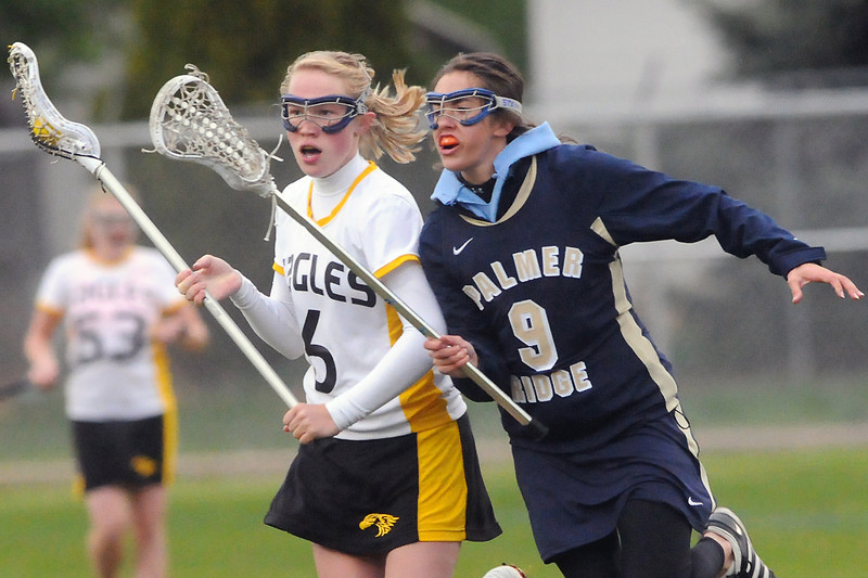 Palmer Ridge High School's Melissa Ross, right, pressures Thompson Valley's Kiera Papish in the first half of their game Wednesday, May 11, 2011 at Patterson Stadium.