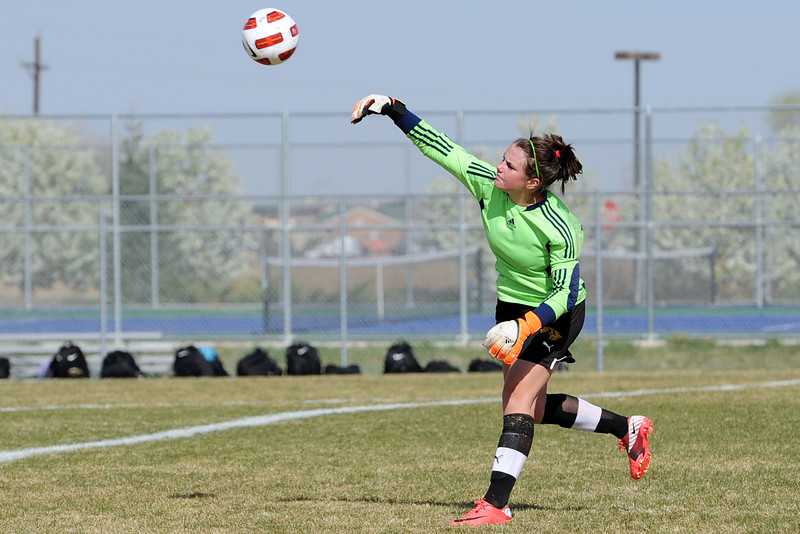 Thompson Valley High School goalie Grace Ramsden puts the ball in play during the first half of a game against Mountain View on Tuesday, April 10, 2012 at MVHS.