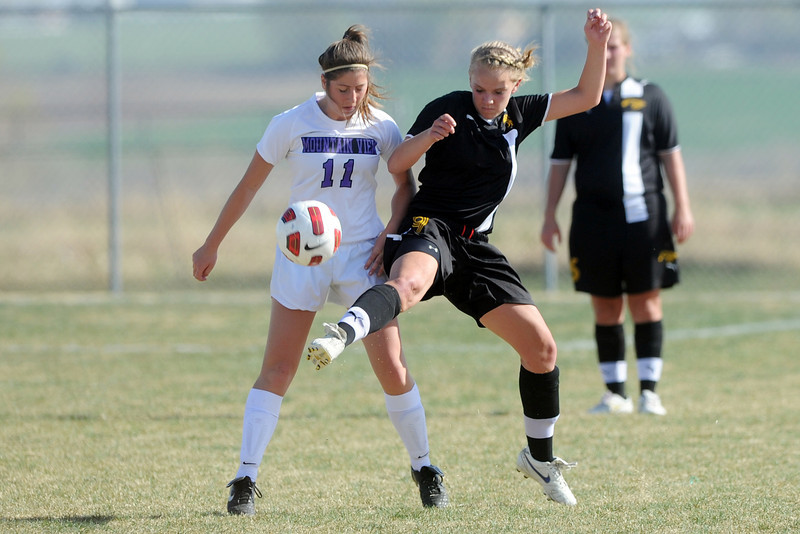 Mountain View High School's Hallie Stolte, left, and Thompson Valley's Jordan Paulsen go up for the ball in the first half of their game Tuesday, April 10, 2012 at MVHS.