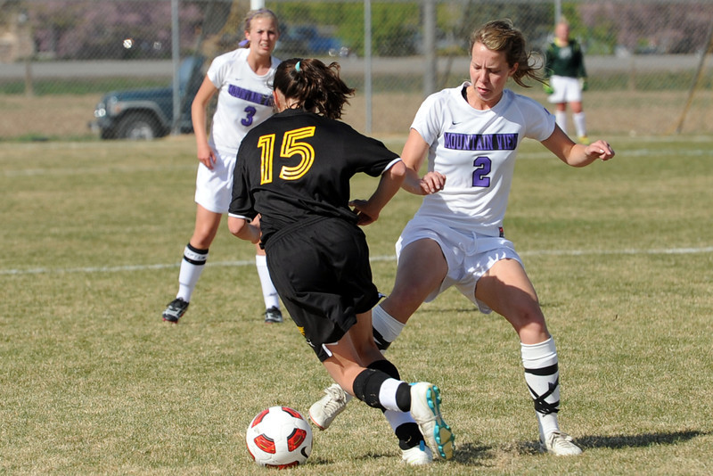 Mountain View High School's Sarah Ross, right, defends against Thompson Valley's Kendra Larson in the first half of their game Tuesday, April 10, 2012 at MVHS.