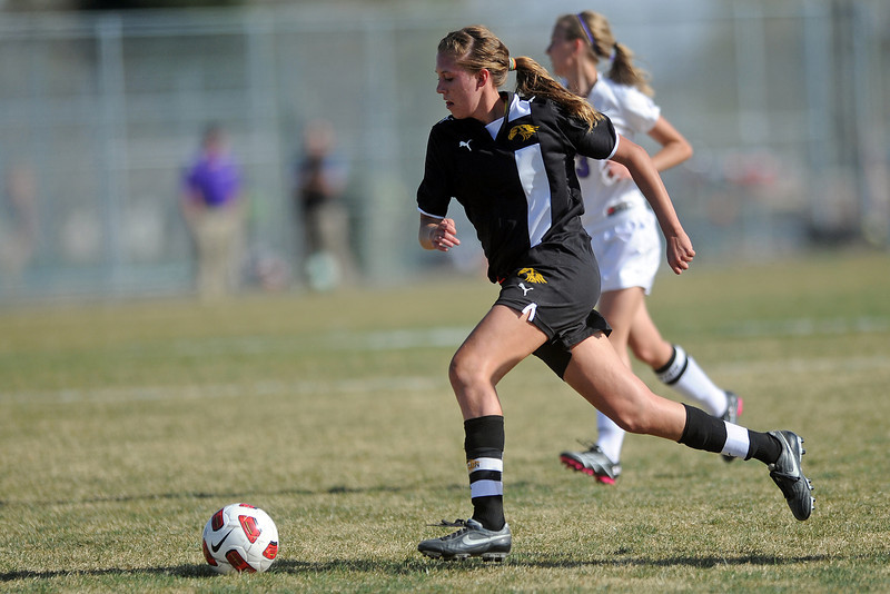 Thompson Valley High School's Paige Chase brings the ball upfield in the first half of a game against Mountain View on Tuesday, April 10, 2012 at MVHS.