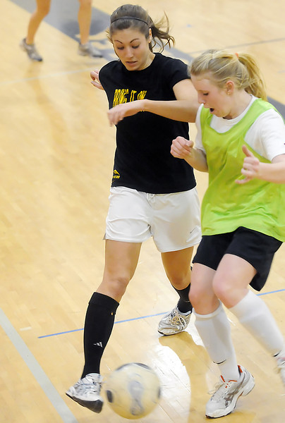 Thompson Valley High School senior Emma Howard, left, and freshman Jordin Campbell battle for control of the ball during soccer practice on Thursday, Feb. 25, 2010 in the school's gymnasium.