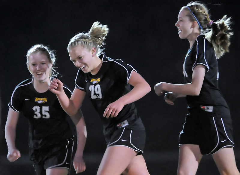 Thompson Valley High School freshman Jordan Paulsen, center, celebrates with teammates Jordin Campbell, left, and Paige Chase after scoring a goal in the first half of a game against Berthod on Wednesday, March 17, 2010 at Marr Field. The Eagles won, 5-0.