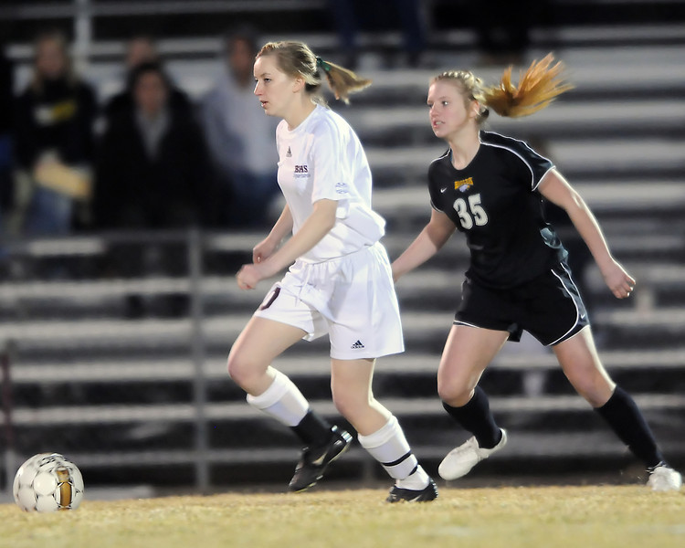 Berthoud High School senior Caitlin Owens, left, dribbles away from Thompson Valley's Jordin Campbell in the first half of their game on Wednesday, March 17, 2010 at Marr Field.