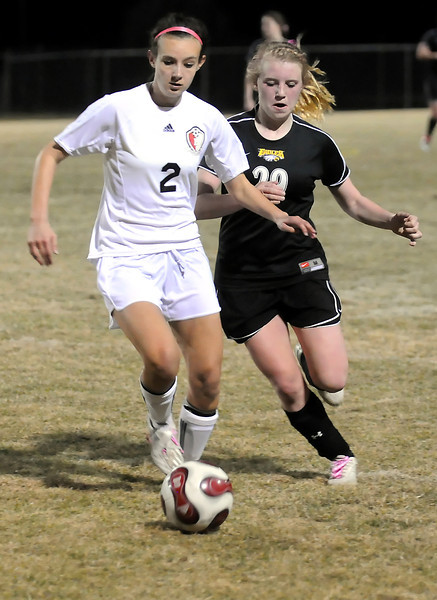 Loveland High School junior Kendra Neubert, left, and Thompson Valley sophomore Jordin Campbell track down the ball in the first half of their game Tuesday night at Patterson Stadium. The Eagles won, 2-1.