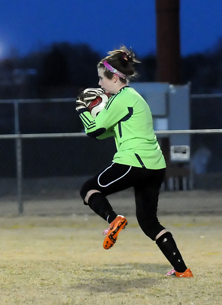 Thompson Valley High School goalie Grace Ramsden makes a stop in the first half of a game against Loveland on Tuesday at Patterson Stadium. The Eagles won, 2-1.