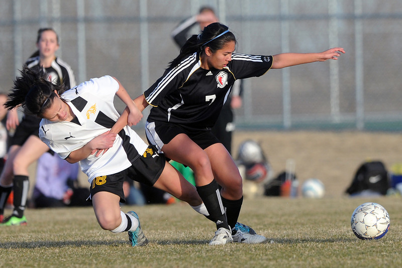 Thompson Valley High School's Ali Artzberger, left, and Loveland's Greta Grainda battle for control of the ball in the first half of their game Tuesday, March 20, 2012 at the Mountain View soccer field.