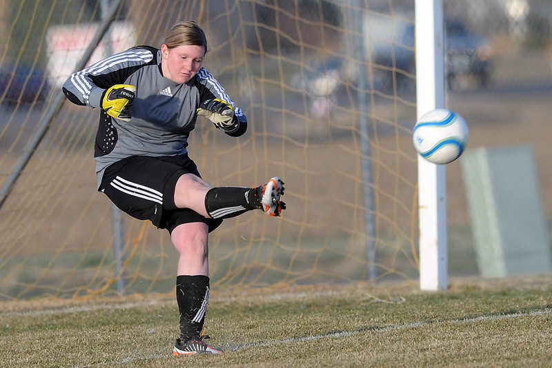 Loveland High School sophomore Jordan Rausch puts the ball in play with a goal kick in the second half of a game against Thompson Valley on Tuesday, March 20, 2012 at the Mountain View soccer field.