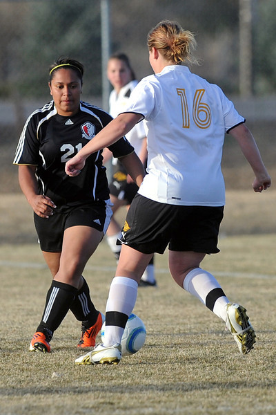 Loveland High School's Karli Wilson, left, and Thompson Valley's Cassie Baalke track down the ball in the second half of their game Tuesday, March 20, 2012 at the Mountain View soccer field.