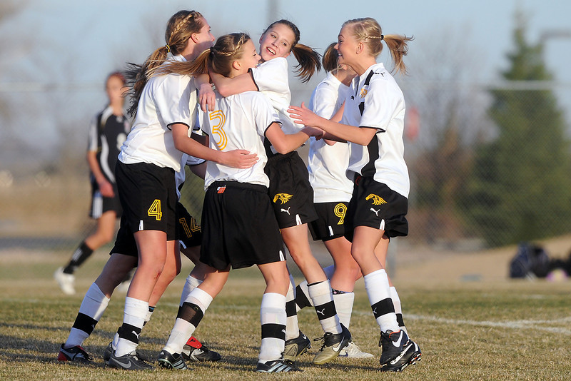 Thompson Valley High School freshman Josi Briggs (3) is congratulated by teammates after scoring a goal in the second half of a game against Loveland on Tuesday, March 20, 2012 at the Mountain View soccer field to tie them at 3-3. Loveland went on to win in overtime, 4-3.
