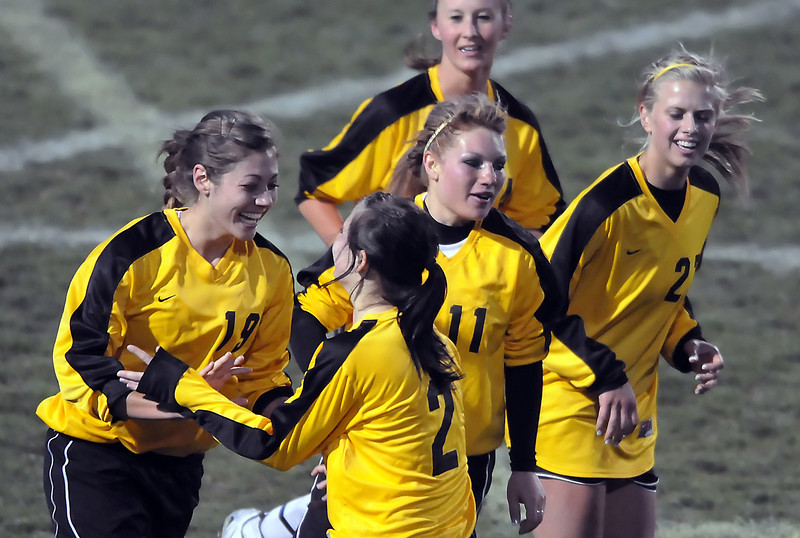 Thompson Valley High School senior Emma Howard, left, is all smiles as she is congratulated by teammates after scoring the first of her two goals during a game against Mountain View on Friday, April 30, 2010 at Patterson Stadium. At rear is Katelyn Bierdron and front from left are Emma, Natalie Howard, who scored one goal, Eraca Sprague and Sydney Paulsen, who added two goals of her own in the Eagles' 5-0 victory over the Mountain Lions.