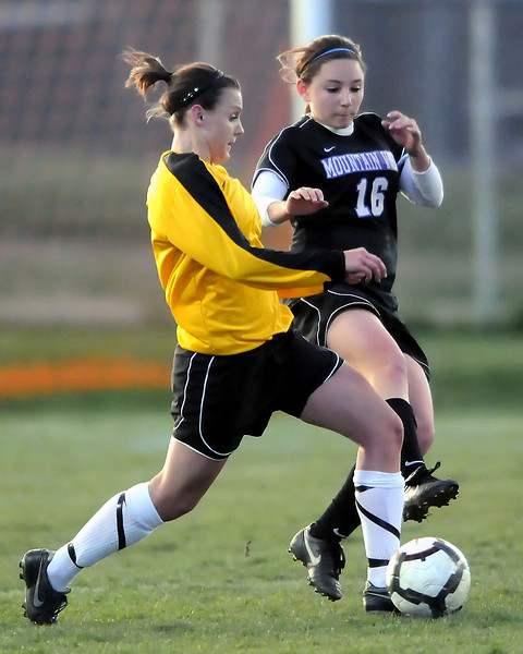 Thompson Valley High School sophomore Jessica Moran, left, and Mountain View sophomore Emily McFeron battle for the ball in the first half of their game on Friday, April 30, 2010 at Patterson Stadium. The Eagles won, 5-0.