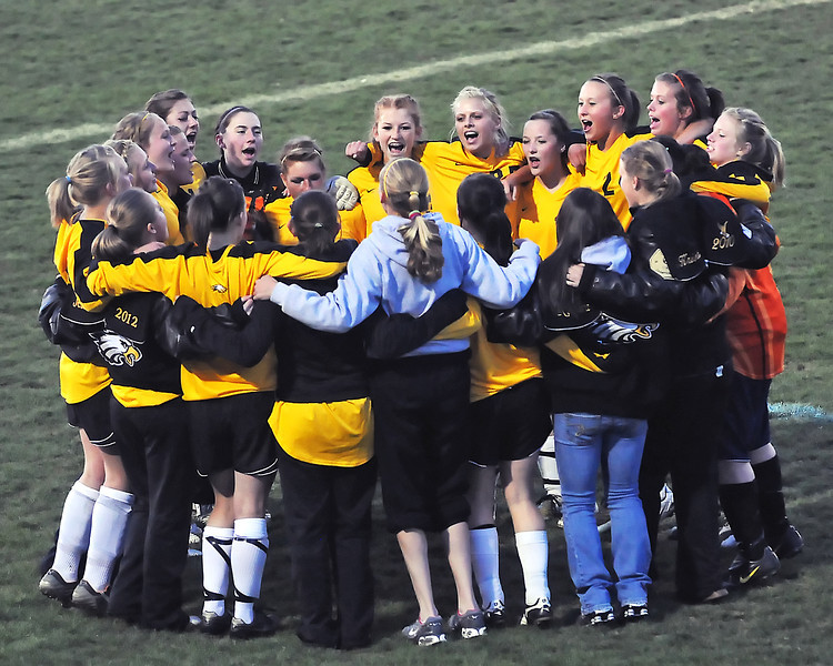 Members of Thompson Valley High School's girls soccer team huddle together before the start of the second half of a game against Mountain View on Friday, April 30, 2010 at Patterson Stadium.