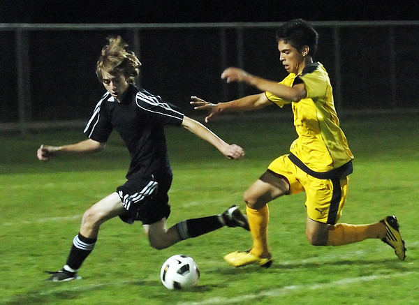 Mountain View High School's Michael Ward, left, and Thompson Valley's Christian Buendia track down the ball in the first half of their game on Thursday, Oct. 7, 2010 at Patterson Stadium.